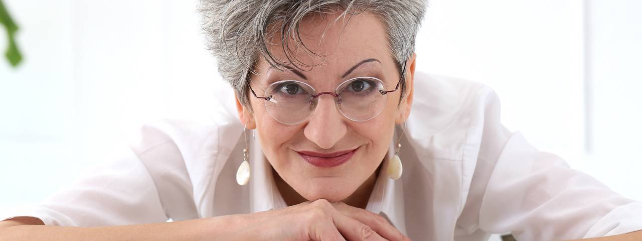 Older-Woman-Smiling-Glasses-1280x480